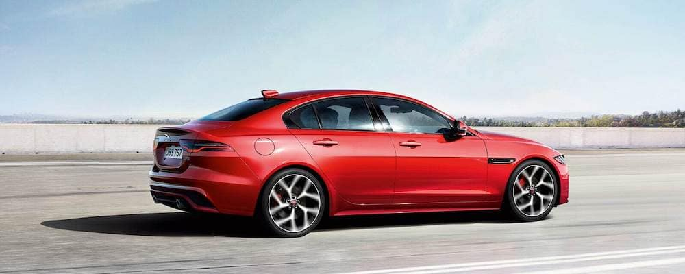 2020 Jaguar XE in red driving on highway