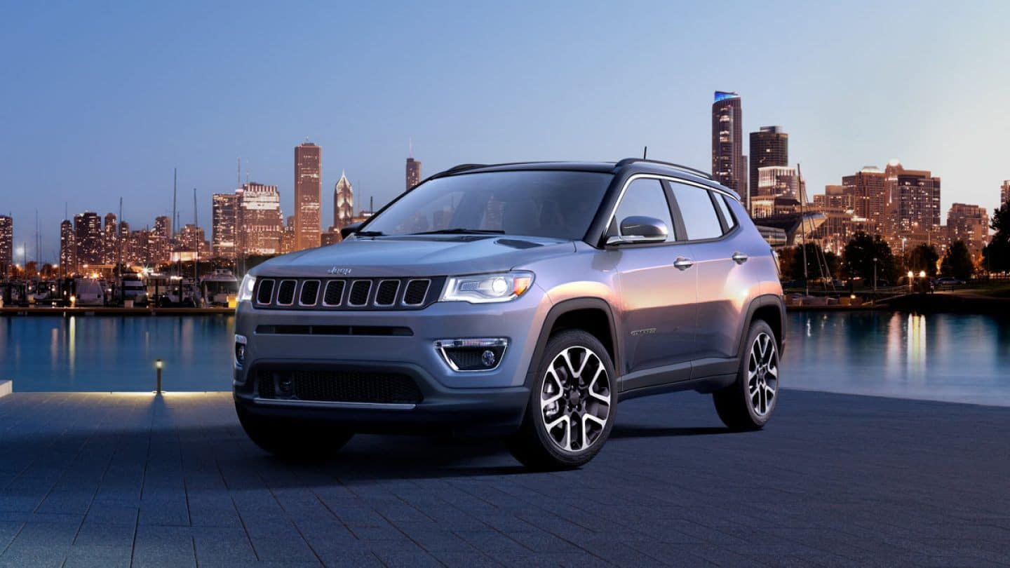 2019 silver Jeep compass on city wtih waterfront