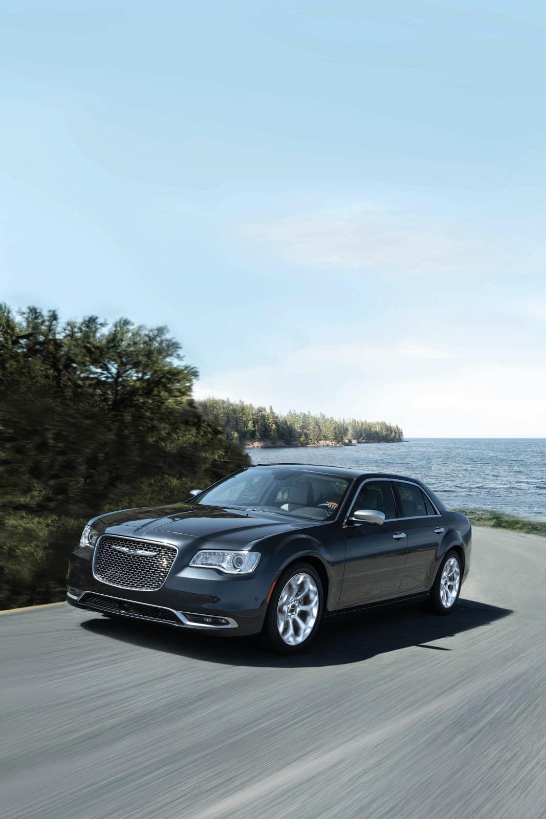 Black Chrysler 300 Driving Down Coastal Highway