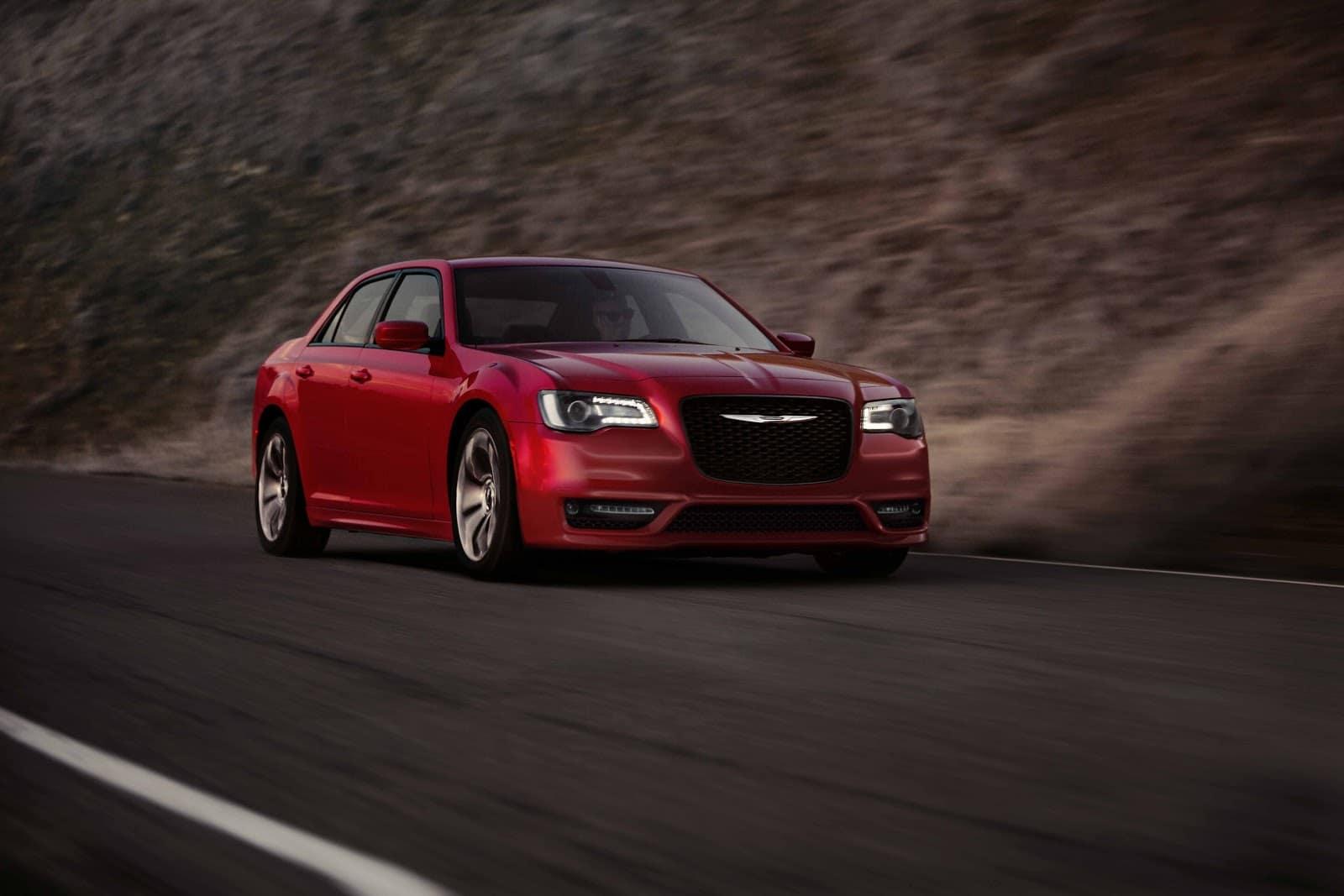 Red 2019 Chrysler 300 Driving Mountainside