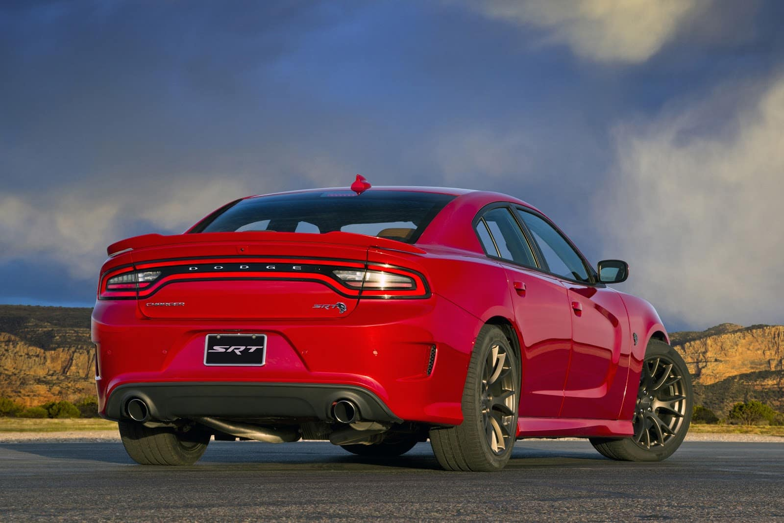 Red Dodge charger back facing user with SRT trim level displayed on tag with rear taillights