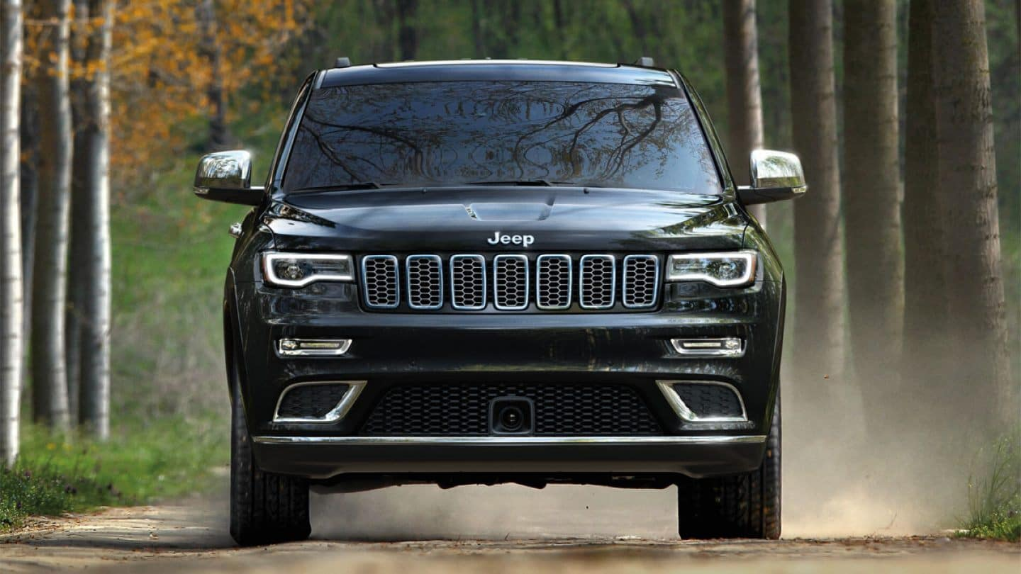 black 2019 jeep grand cherokee driving