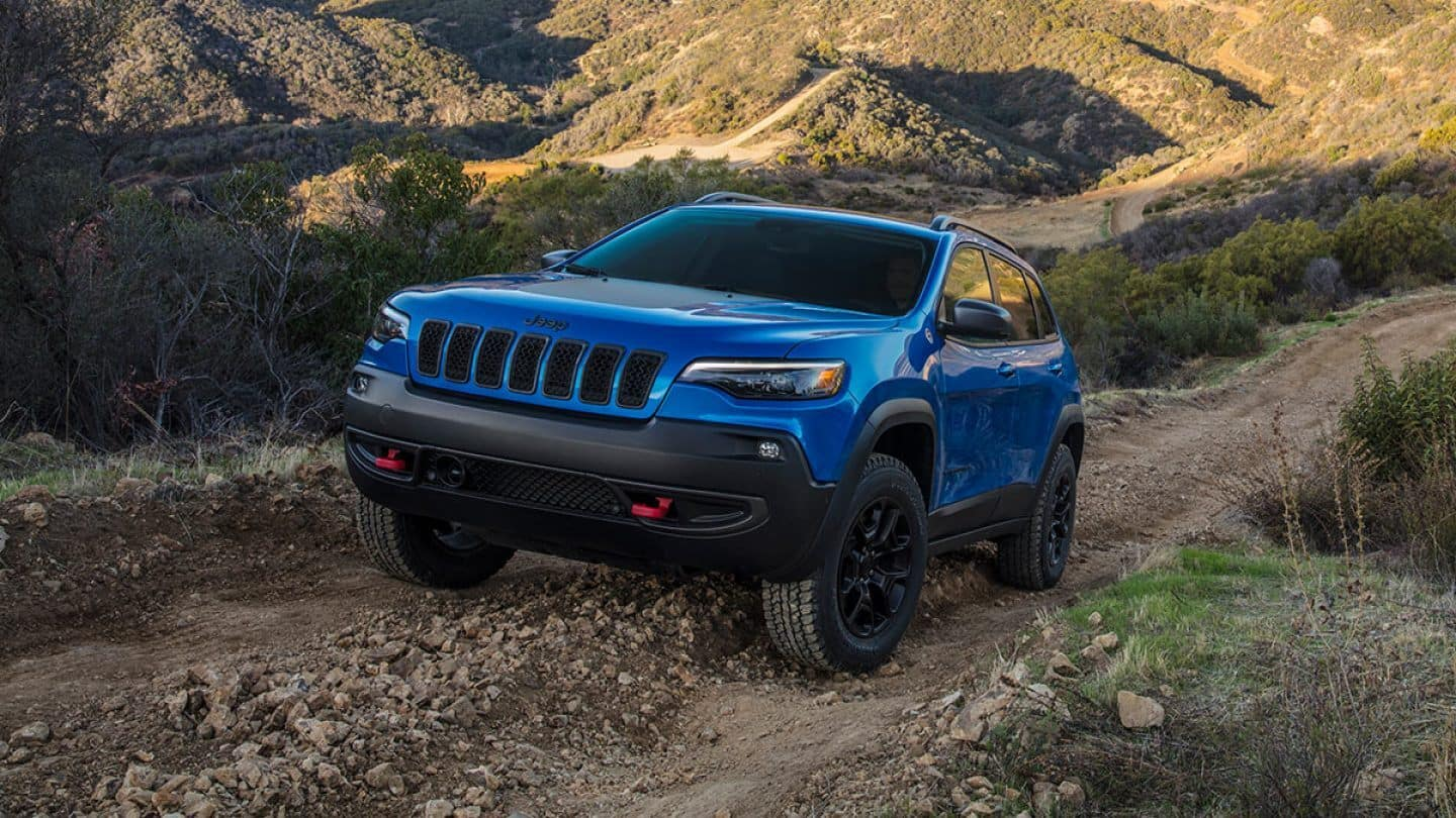 blue 2019 jeep cherokee on trail