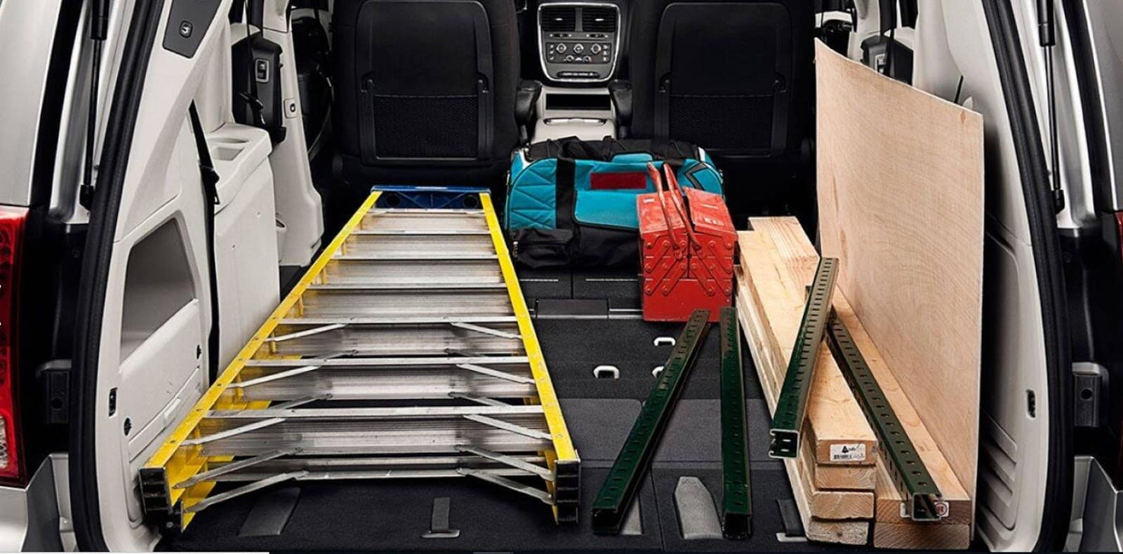 capability of storage in the dodge grand caravan with the folding seats showcased by ladder fitting, heavy wood, duffle bags, and other tools