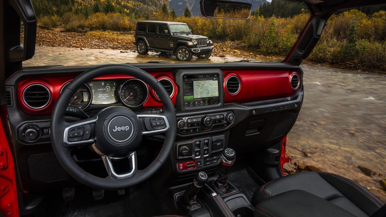 jeep wrangler interior while going through stream in mountains