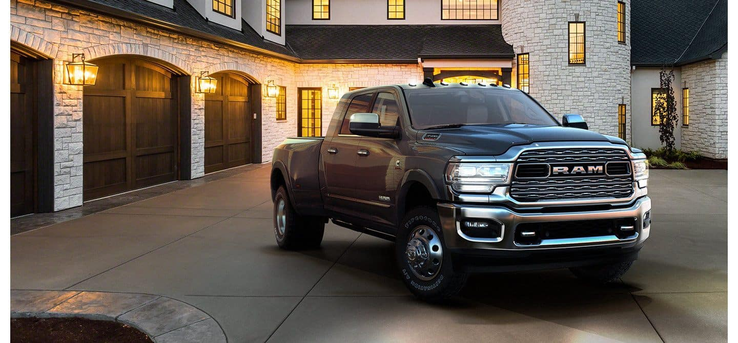 ram 3500 parked against luxurious stone house
