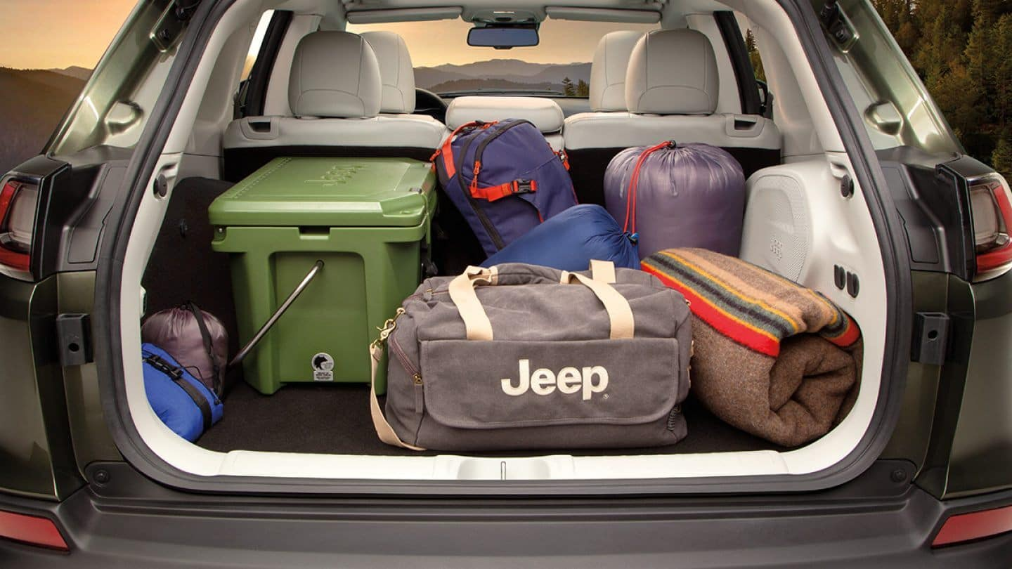 truck of 2019 jeep cherokee loaded with jeep memoribilia
