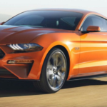 Orange Ford Mustang on Road
