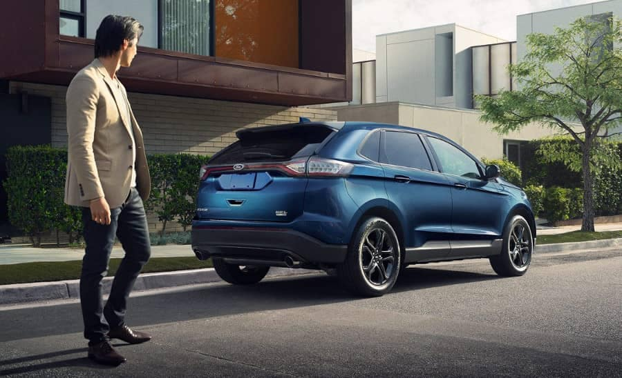 man looks at 2018 Ford Edge