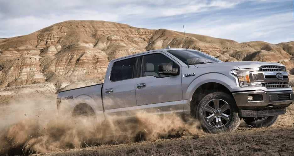 2019 Ford F-150 XLT SuperCrew in silver driving off road