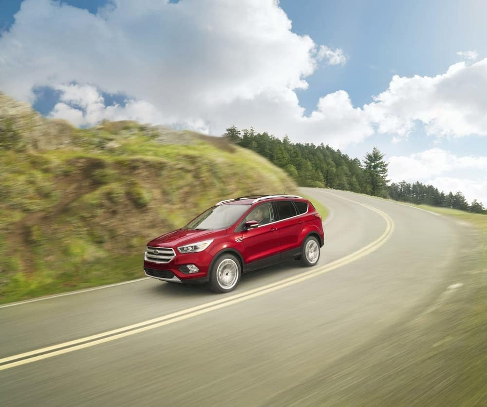2019 Ford Escape driving down curved road