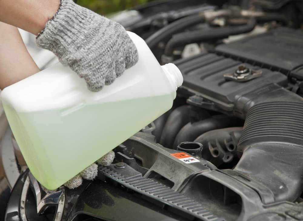 Adding coolant to a car