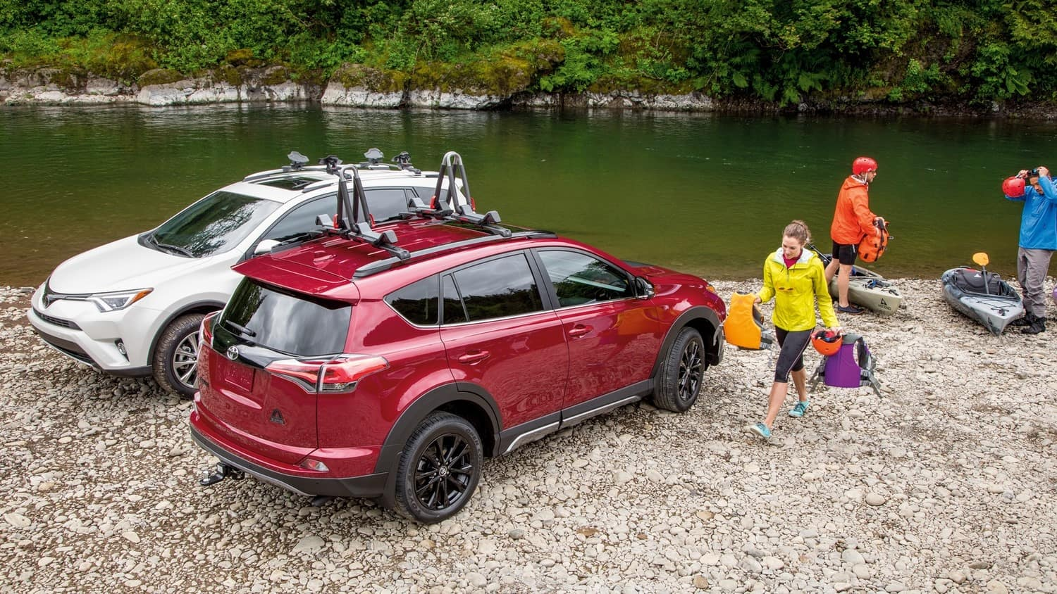 Rav4's near rivers edge with gear