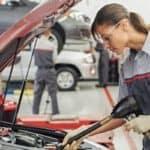 woman servicing car