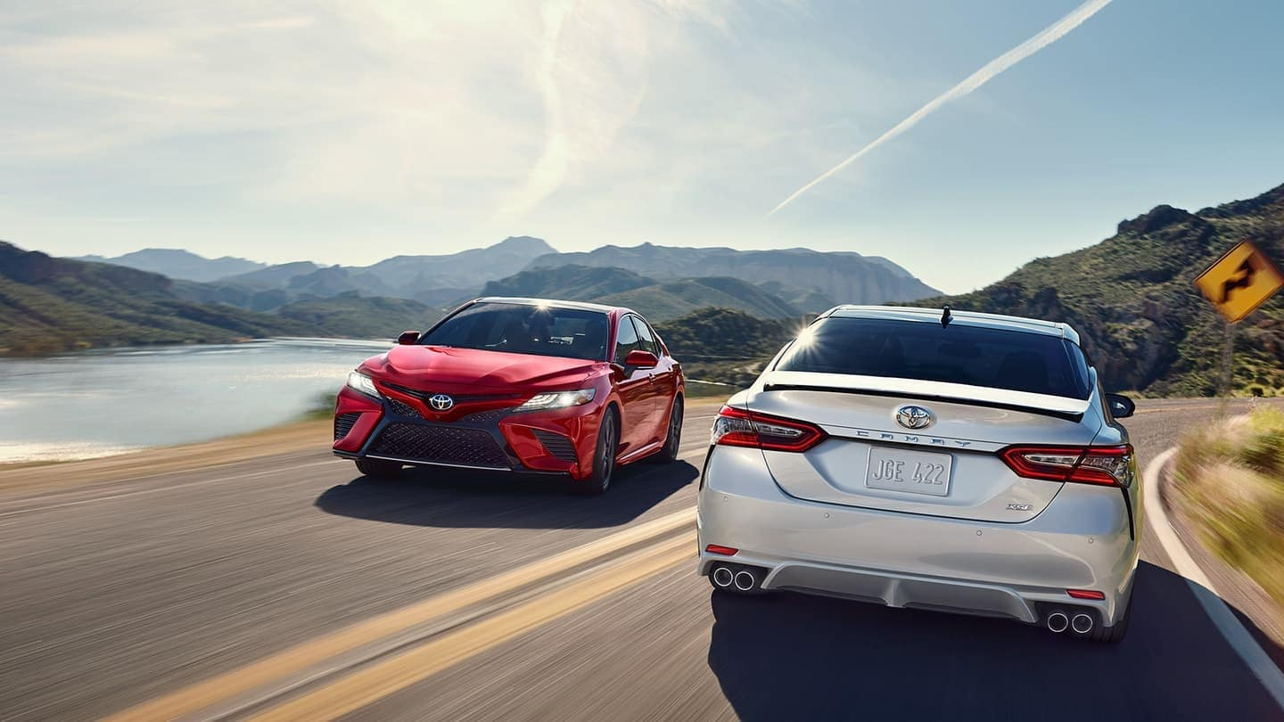 2 2019 Toyota Camry Cars driving on opposite sides of the road