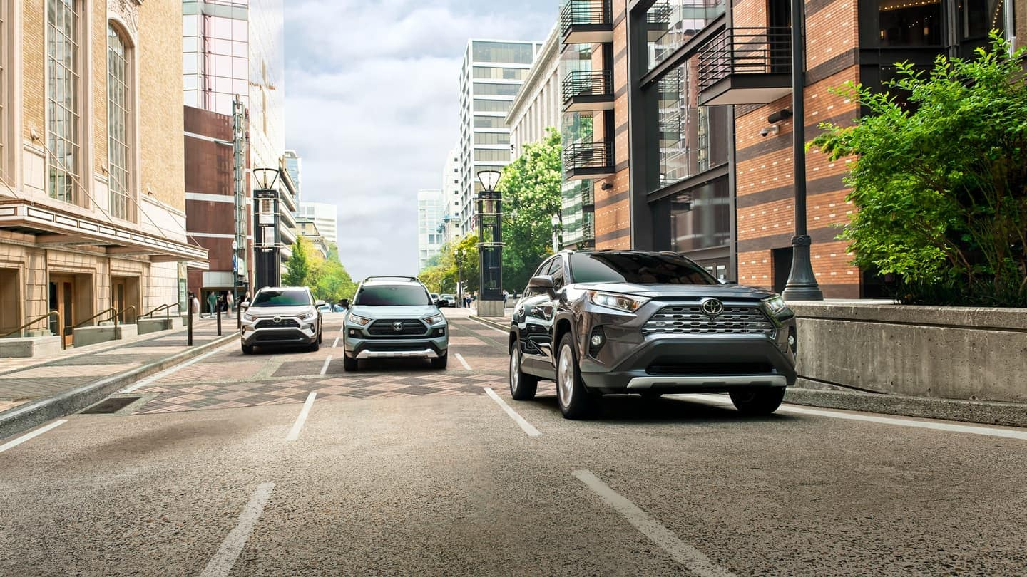 2019 Toyota RAV4 models driving down the road