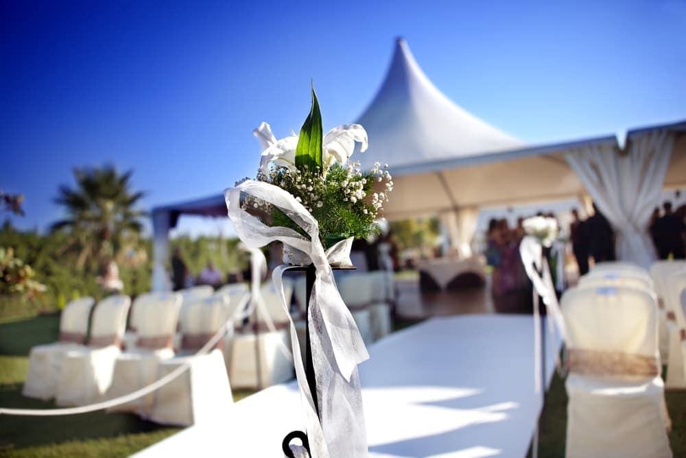 Outdoor wedding ceremony table centerpiece