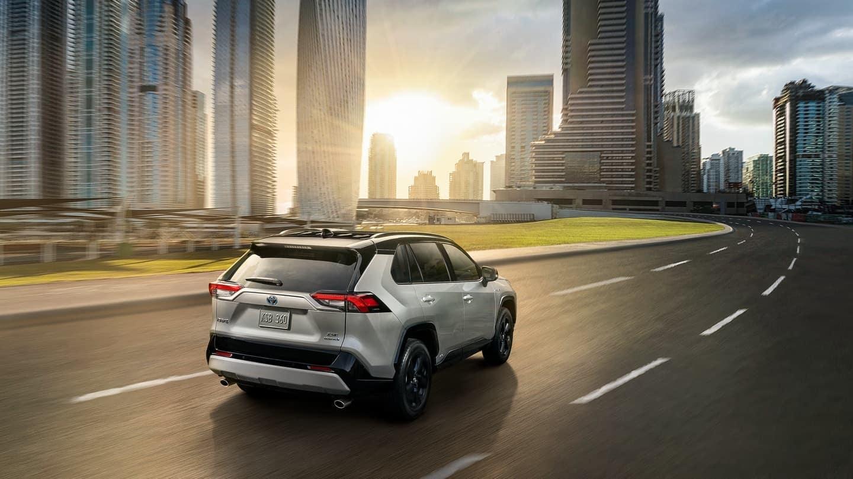 2019 Toyota RAV4 hybrid rear aerial view driving