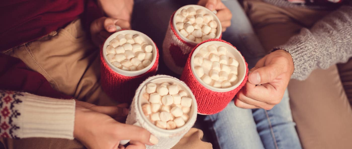 family drinking hot cocoa in winter