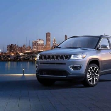 2019 Jeep Compass with city in the background