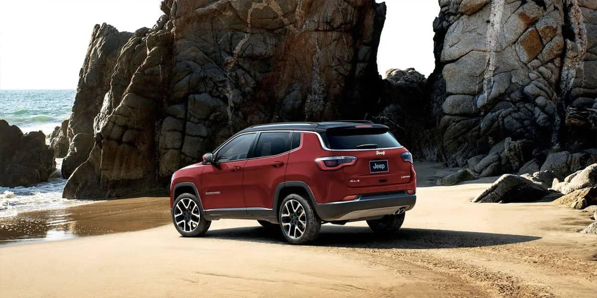 2019 Jeep Compass parked on beach