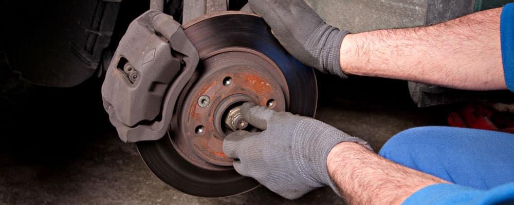 Man Repairing Brake Pad