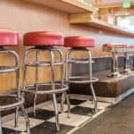 Restaurant diner with interior stools