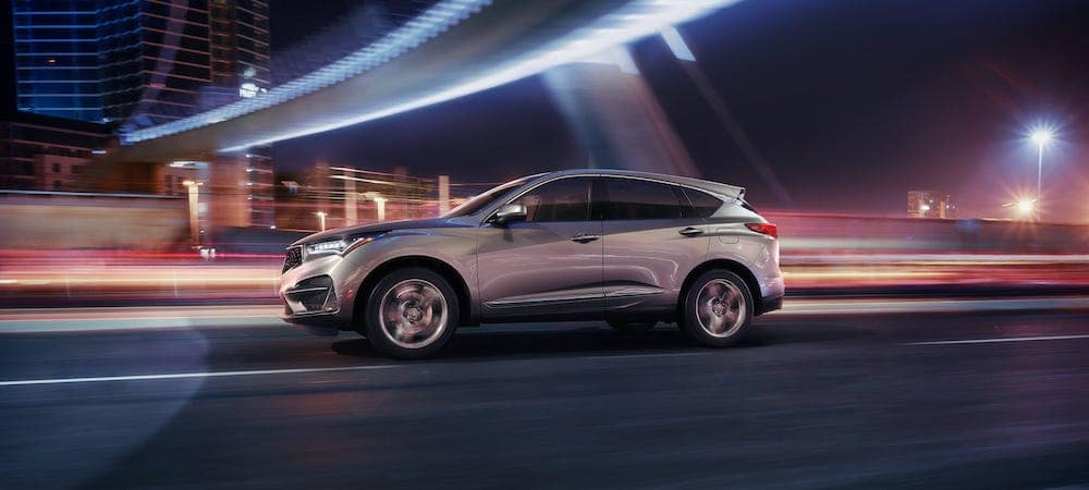 Silver 2020 Acura RDX driving against blurred city street