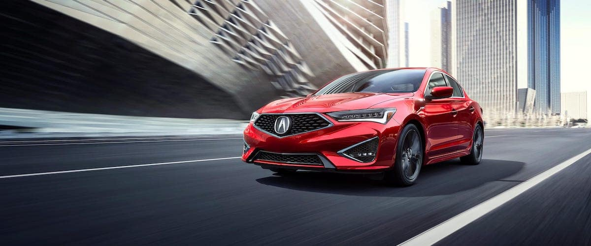 Red 2020 Acura ILX driving on city street