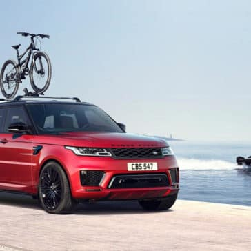 2018 Land Rover Range Rover Sport driving with bike rack