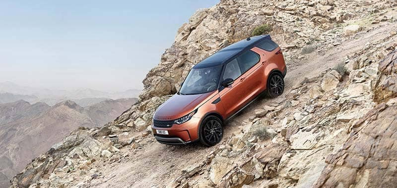 2018 Land Rover Discovery Driving Down Rocky Hill