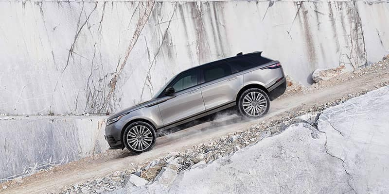 2018 Land Rover Range Rover Velar Driving Down Gravel Hill