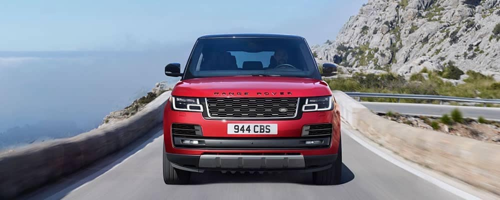 Front view of red 2019 Land Rover Range Rover exterior in front of a clear blue sky