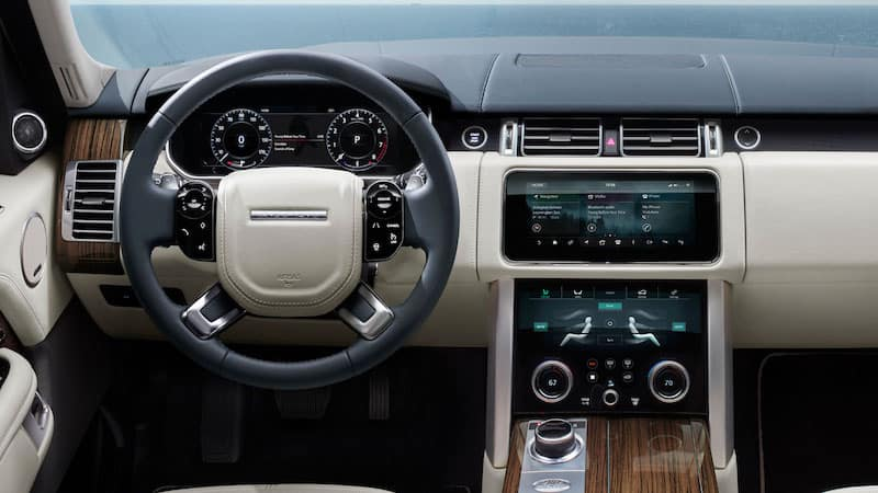 Tan Range Rover dashboard and steering wheel