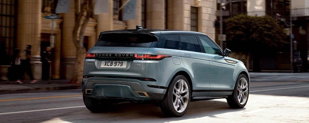 2020 Range Rover Evoque in light blue driving on city street