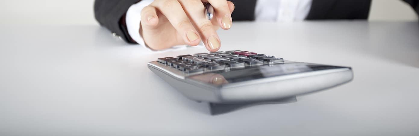 Women Typing on Calcilator
