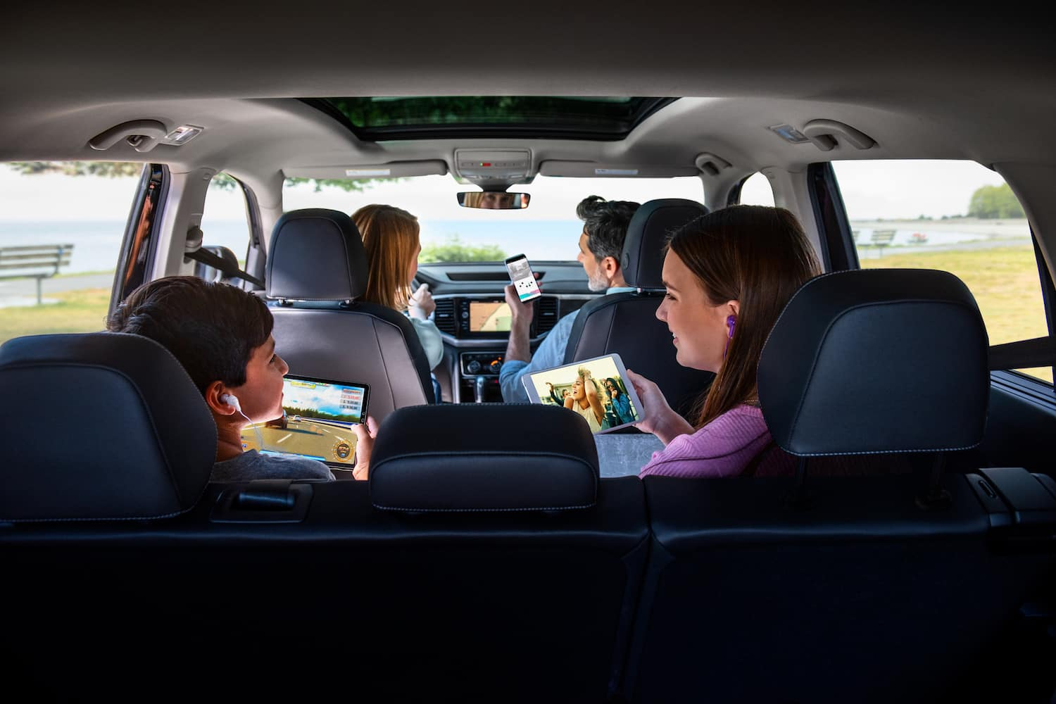 Family in Car on devices