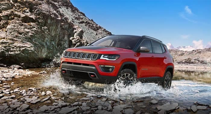 Jeep Compass Off-Roading Through Water and Rocks