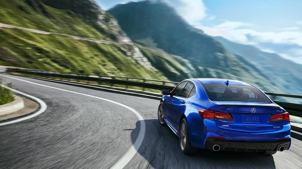 Blue Acura TLX on Mountain Road