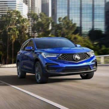 Blue 2019 Acura RDX Driving in City Street