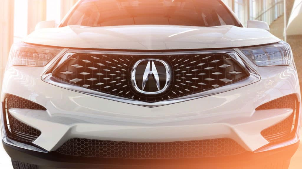 Acura logo on grille of white Acura model