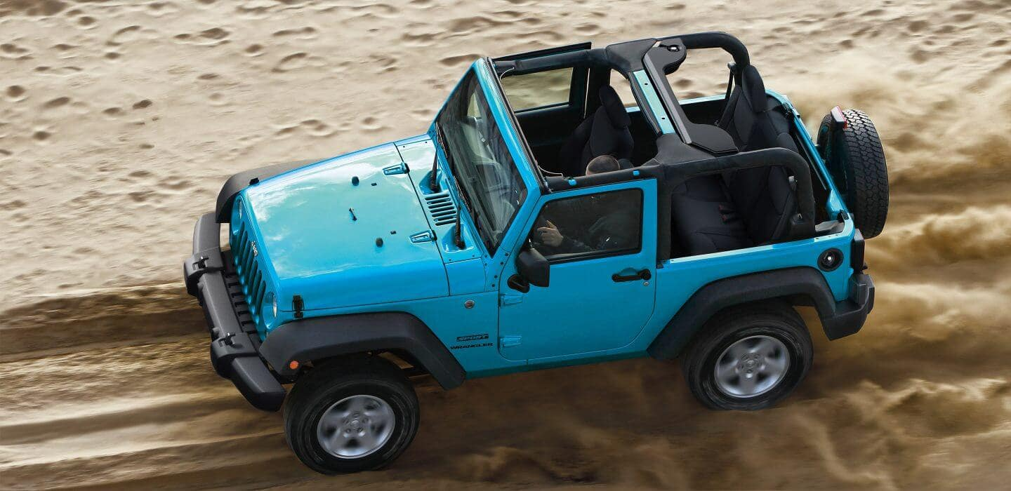 2017 Jeep Wrangler driving on sand