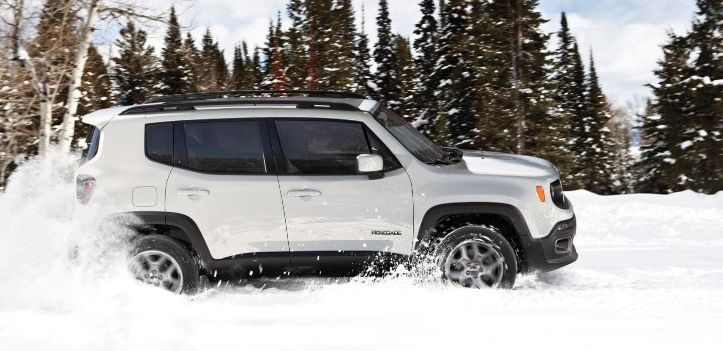 2017 Jeep Renegade driving through snow