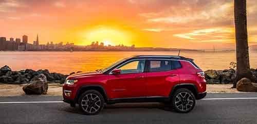 2018 Jeep Compass parked outside the beach at sunset