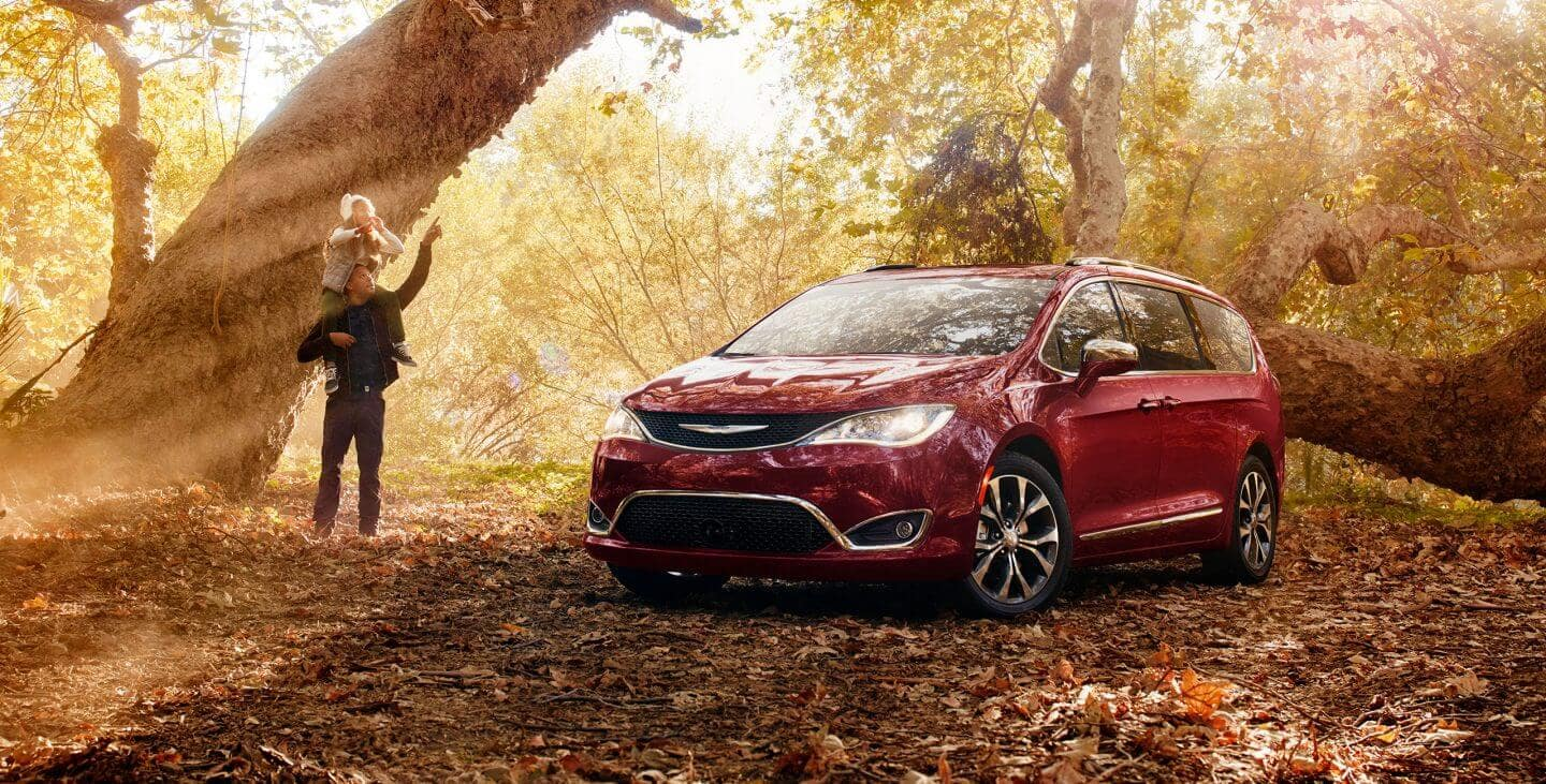 2018 Chrysler Pacifica parked in forest by a tree