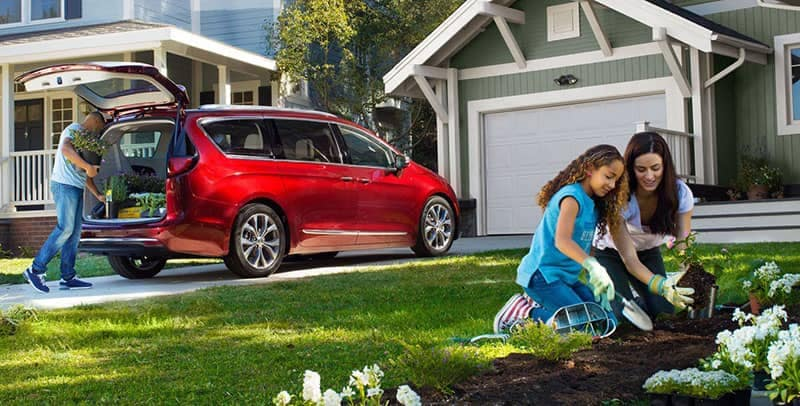 2018 Chrysler Pacifica Parked Outside Home with Flowers in Cargo Area