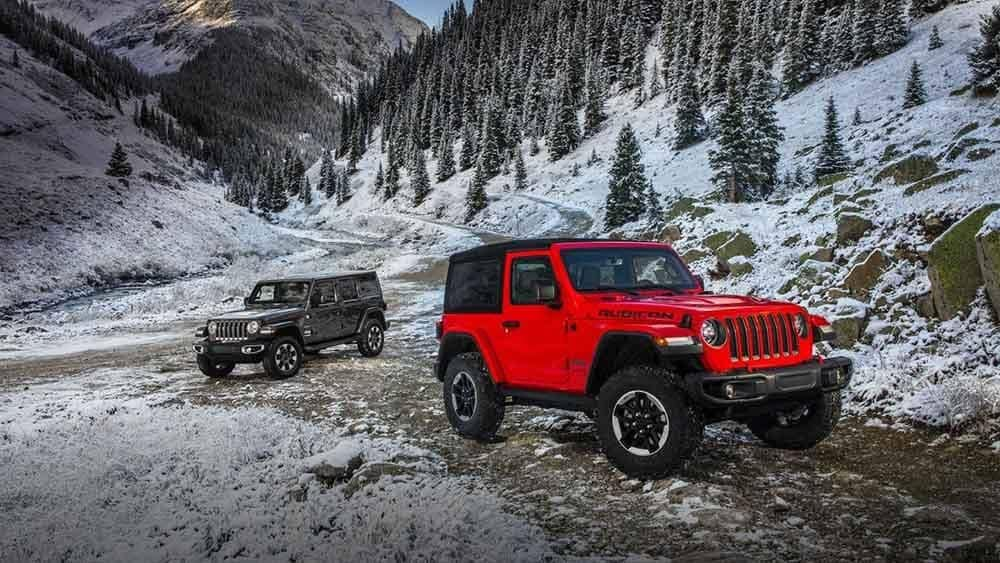 2018 Jeep Wrangler Models Parked at Bottom of Mountains