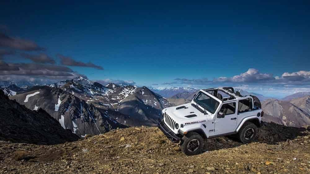 2019 Jeep Wrangler With Top Off Parked on Top of Mountain