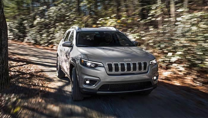 Jeep Cherokee Driving Through Woods