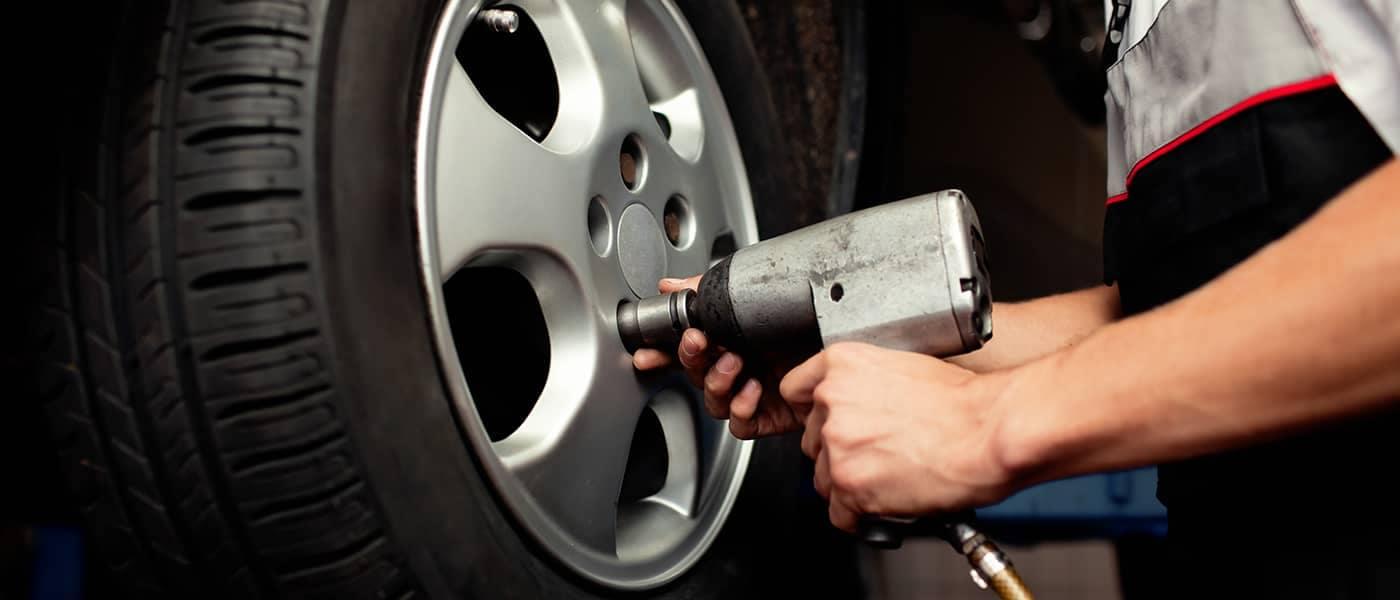 Mechanic Tightening Tire